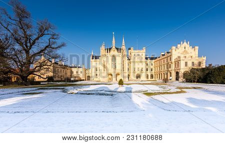 The Lednice Castle Panorama In Snow, Winter. Beautiful Old Historical Architecture, Blue Sky. Czech