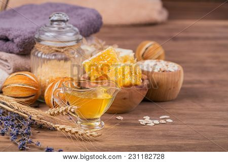 Honeycomb, Sea Salt, Oatmeal And Handmade Soap With Honey On Rustic Wooden Background. Natural Ingre