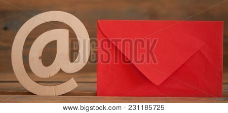 E-mail at symbol and envelope on a desk