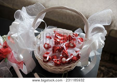 Straw Basket With Decorative Elements And Accessories For Wedding