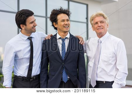 Closeup Of Business Team Of Three Happy Diverse People Standing Outdoors With Building In Background