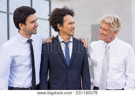 Closeup Of Business Team Of Three Relaxed Diverse People Chatting And Standing Outdoors With Buildin