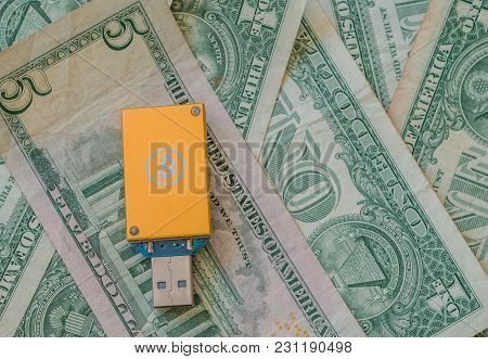Gold Thumb Drive Usb Bitcoin Miner On Top Of Stack Of American Money