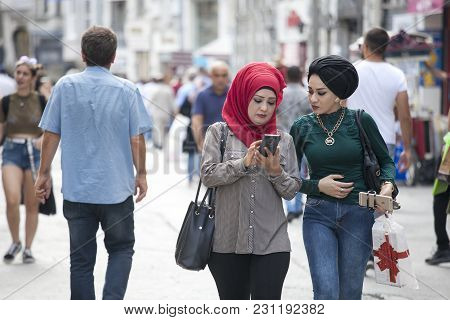 Istanbul Turkey 05 July 2017 People At Istiklal. Girls Student In Beautiful Headscarves Walking Down
