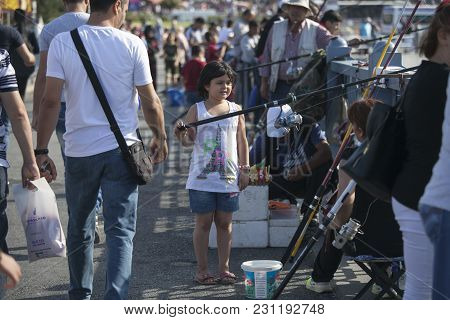 Istanbul Turkey 05 July 2017 Fishing For Sardines On The The Galata Bridge.