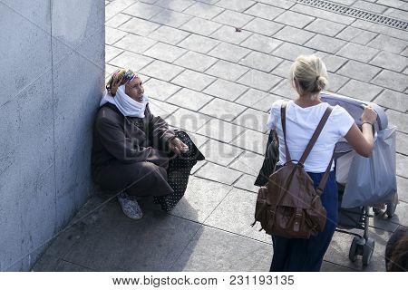 Istanbul Turkey 05 July 2017 A Beggar Woman In A Scarf On The Pier