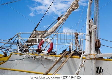 Part Of A Large Ship With A Lifeline, And Mast