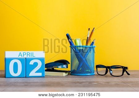 April 2nd. Day 2 Of April Month, Calendar On Table With Yellow Background And Office Or School Suppl