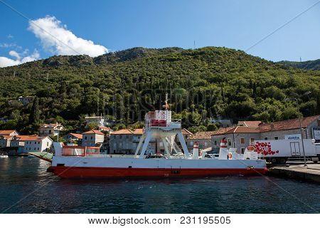 Boko-kotor Bay, Montenegro - September 21: Large Ferry Unloads Passenger Cars And Truckalong The Bay