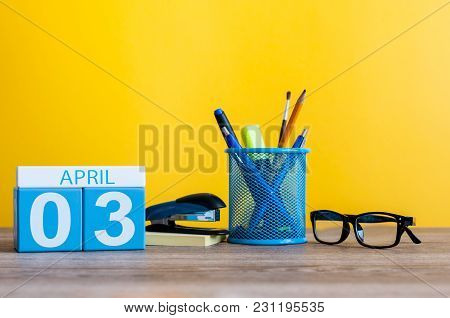 April 3rd. Day 3 Of April Month, Calendar On Table With Yellow Background And Office Or School Suppl