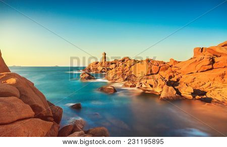 Ploumanach Mean Ruz Lighthouse Red Sunset In Pink Granite Coast, Perros Guirec, Brittany, France. Lo