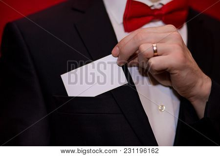 Stylish Man In Suit Hold White Business Card On Red Background, Focus On Business Card. Business Con