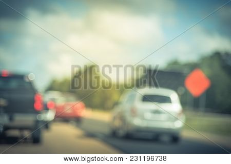 Blurred Traffic On Us Highway 59 Caused By Road Construction. Barricades, Large Sewer Pipes, And Roa