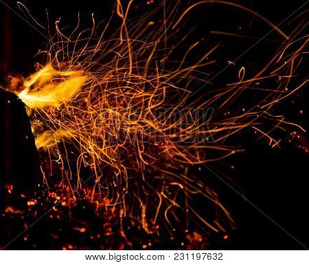 Fire With Sparks On A Black Background .