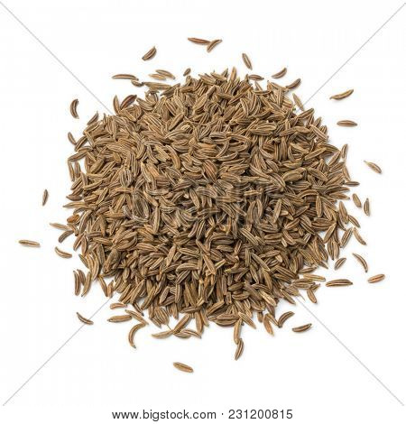 Heap of Caraway seeds isolated on white background