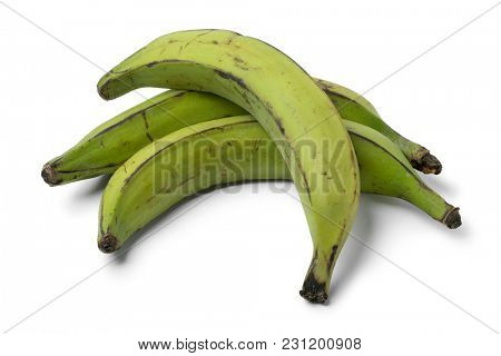 Whole green unripe bananas isolated on white background