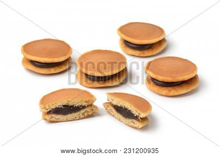 Whole and half Japanese Dorayaki close up isolated on white background