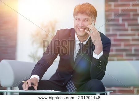 portrait of a successful businessman with a smartphone