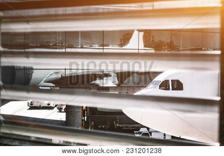View Through The Rare Stripes Of The Window Shutter In A Modern Airport Terminal Of The Airplane Nos