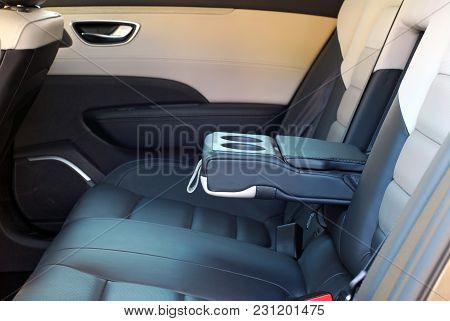 Armrest In Car With Cans Open, Rear Seats