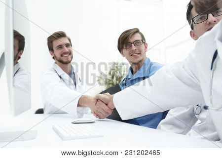handshake two medical colleagues
