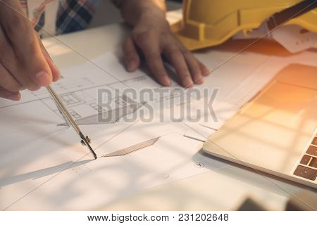Architecture Drawing Plan On Blue Print With Architect Tools On His Workplace