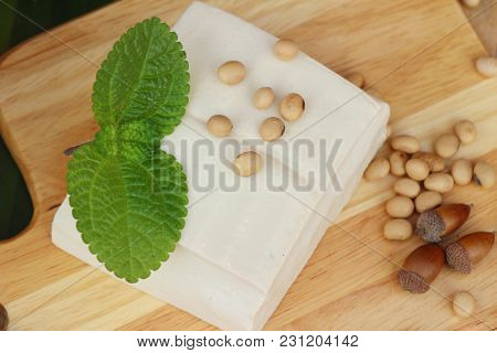 Tofu And Soybean Seed On Wood Background