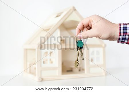 Businessman's Hand Giving Key From New House.  Real Estate For Rent.  Big Deal Offer. Special Propos