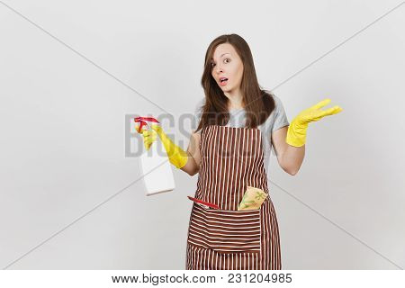Young Sad Upset Bewildered Housewife In Yellow Gloves Striped Apron Cleaning Rag Squeegee In Pocket