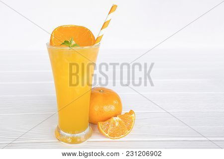 Orange Smoothies, Fruit Juices And Orange Fruits. Drink On A Healthy Summer Vacation On Whitewood Ba