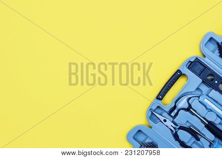 Toolbox Set Of Tools. Home Improvement Concept On Yellow Background. Copy Space.