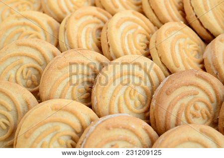 Close-up Of A Large Number Of Round Cookies With Coconut Filling