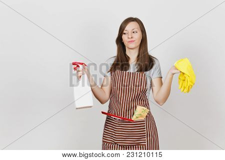 Young Sad Upset Tired Housewife In Striped Apron With Cleaning Rag Squeegee In Pocket Isolated On Wh