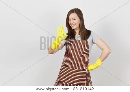 Young Attractive Smiling Brunette Housewife In Striped Apron, Yellow Gloves Isolated On White Backgr