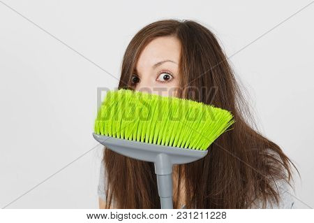 Close Up Of Young Fun Crazy Dizzy Loony Wild Scared Housewife With Tousled Hair Isolated On White Ba