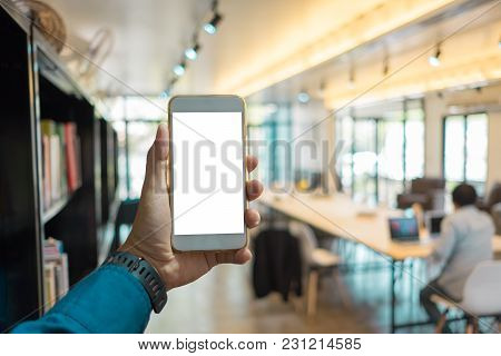 Young Asian Man Holding A Phone At Library