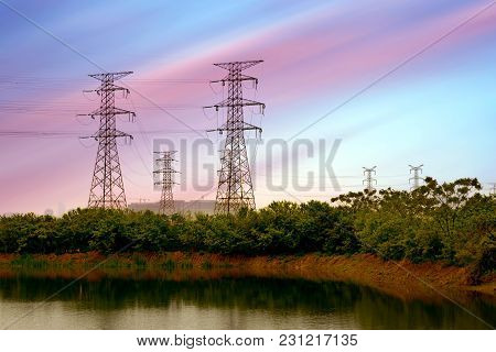 A High Pressure Tower Under The Background Of The Colorful Sky.