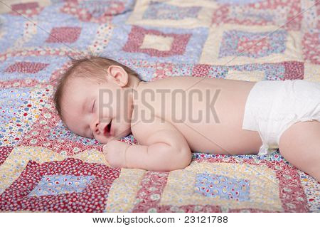 Smiling sleeping baby