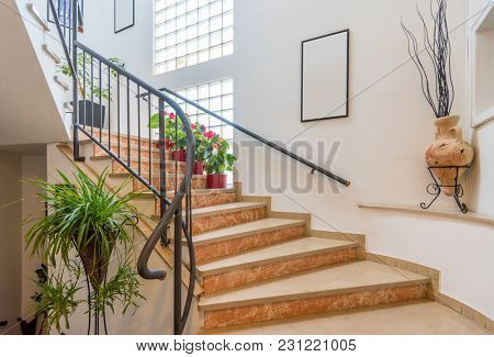 Beautiful room interior in new luxury home. View of stairs, and second story area.