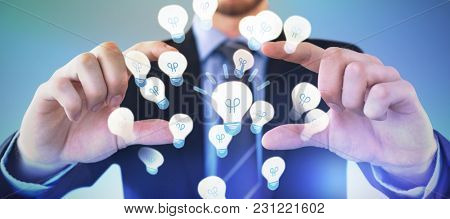 Mid section of businessman wearing suit while advertising invisible product against abstract blue background