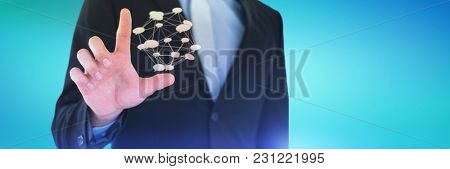 Mid section of businessman touching imaginary interface screen against abstract blue background