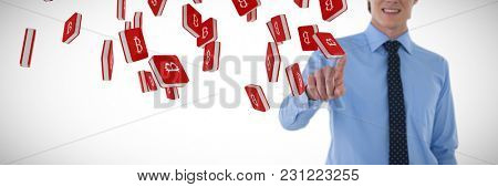 Mid section of smiling businessman using interface while standing with hand in pocket against bit coin symbol