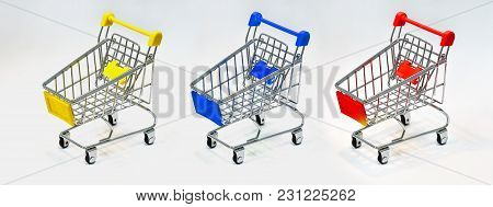 Close The Grocery Store In The Supermarket And Push The Shopping Cart With The Yellow, Red And Blue