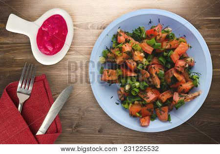 Vegetarian Food . Tomatoes, Onion, Fennel On A Plate On A Wooden Background. Healthy Food