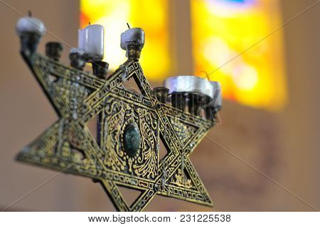 Star Of David In The Fashion Of A Menorah With Candles.