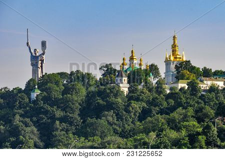 Motherland Statue And Saint Andrew Church In Kiev, Ukraine.