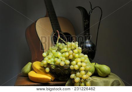 Still life in the Venetian style. Still life with fruit and guitar