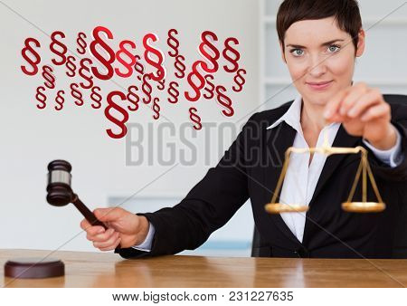 Digital composite of Justice gavel and balance scales and section symbol icons