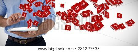 Mid section of male executive using digital tablet against bit coin symbol