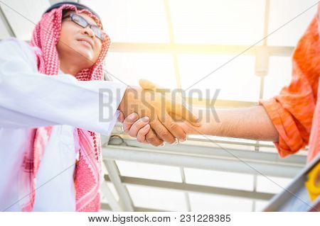 Successful Arab Saudi Emirates Businessman Shaking Hands Over A Deal